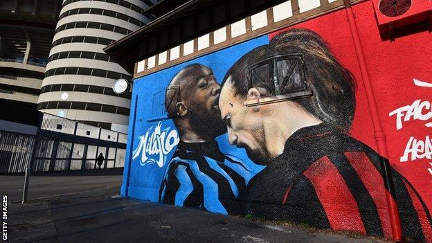 A mural of the clash between Romelu Lukaku and Zlatan Ibrahimovic next to the San Siro