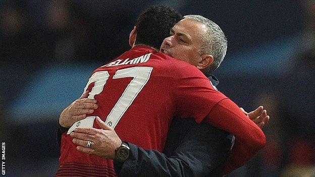 Marouane Fellaini hugs Jose Mourinho