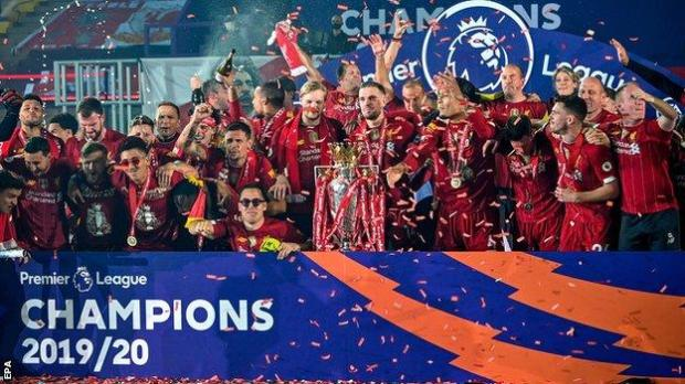 Liverpool's players celebrate as they lift the Premier League trophy