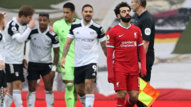 Liverpool forward Mohamed Salah reacts after Fulham take the lead at Anfield