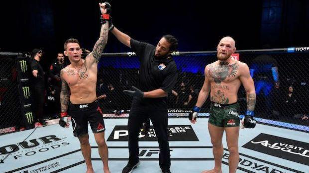 Dustin Poirier has his hand raised as he is declared winner of his second fight with Conor McGregor