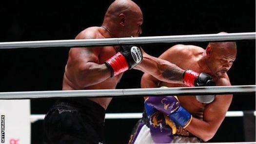 Tyson punches Jones