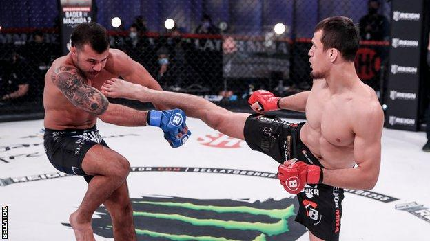 Usman nurmagomedov (right) kicks mike hamel at bellator 255