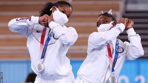 Jordan Chiles and Simone Biles celebrate USA's silver medal in the women's team final at Tokyo 2020