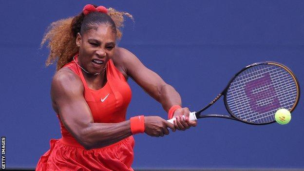 Serena Williams hits a backhand