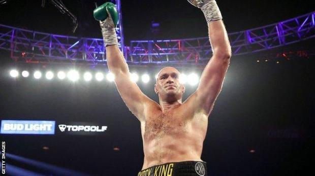Tyson Fury celebrates after knocking down Deontay Wilder.