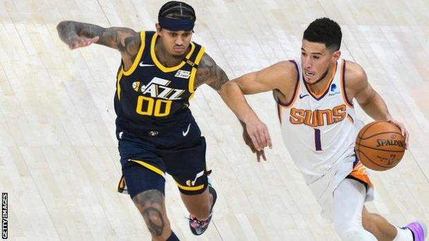 Devin Booker dribbles against Utah Jazz