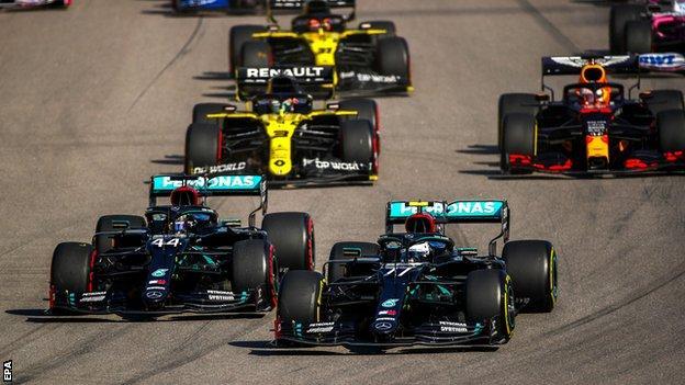 Valtteri Bottas passes Lewis Hamilton at the start of the Russian Grand Prix
