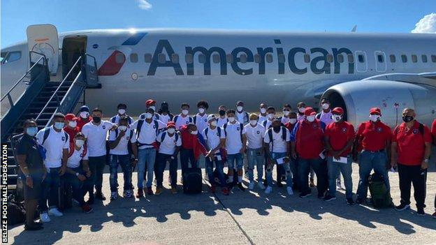 The Belize team posing outside an airplane before flying to Haiti