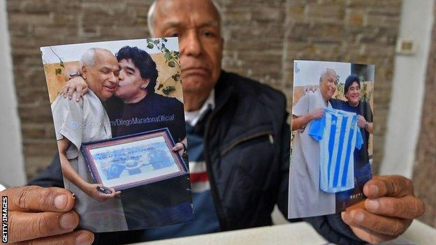 Former referee Ali Bin Nasser with his photographs of Maradona