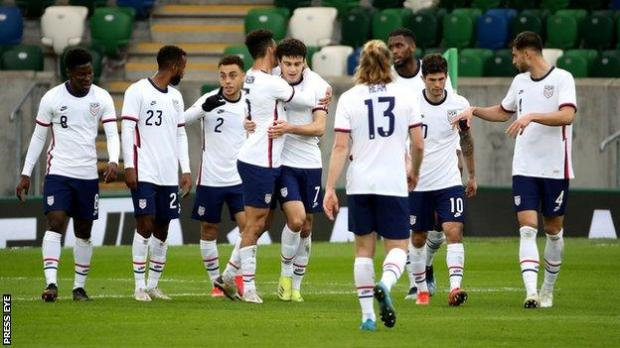 The USA celebrate their first goal against Northern Ireland
