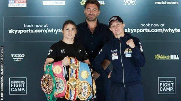 Taylor holds her belts alongside promoter Eddie Hearn and Delfine Persoon