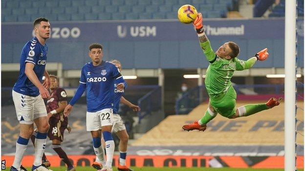Everton goalkeeper Jordan Pickford denies Raphinha a goal with save in the Premier League match with Leeds United at Goodison Park