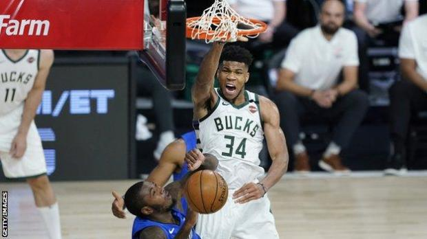 Milwaukee Bucks star Giannis Antetokounmpo dunks over Gary Clark of the Orlando Magic