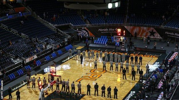 Orlando Magic and Denver Nuggets holding a moment of silence