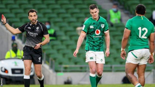 Referee Mathieu Raynal sends off Bundee Aki (right)