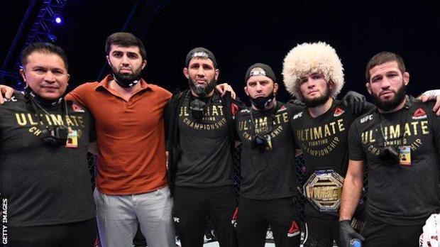 Khabib Nurmagomedov (second right) with his team