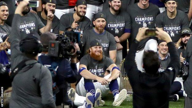The LA Dodgers posing for a team photo after winning the World Series