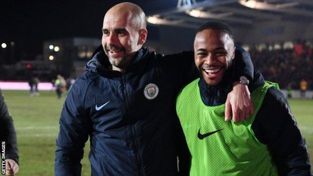 Pep Guardiola and Raheem Sterling