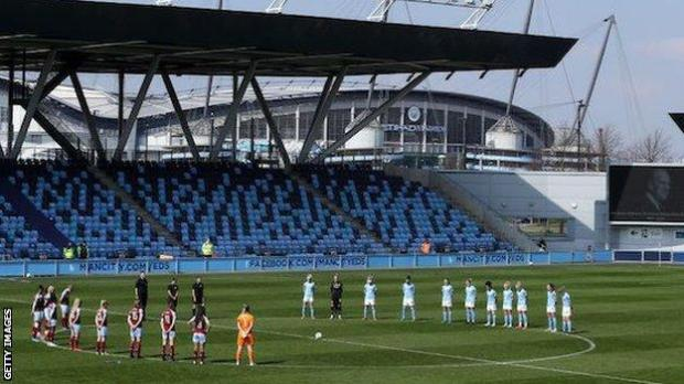 A minute's silence is held before the Women's FA Cup fourth round match between Manchester City and Aston Villa