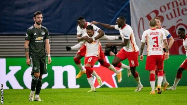 Bruno Fernandes (left) reacts as RB Leipzig celebrate