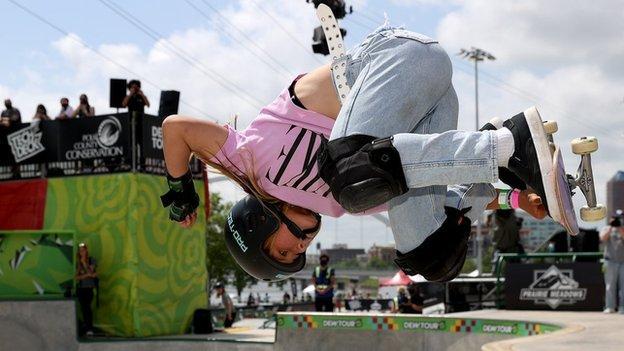 Skateboarder Sky Brown doing a flip