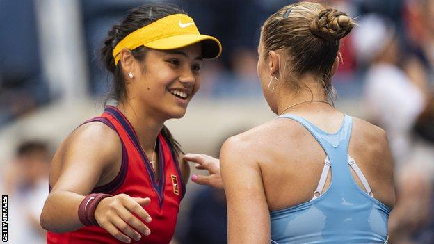 Emma Raducanu shakes hands with Shelby Rogers after their US Open last-16 match