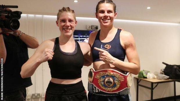 Rankin (left) visited the new champion in her changing room after the bout