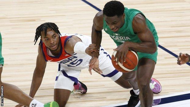Darius Garland of the United States fouls Caleb Agada of Nigeria