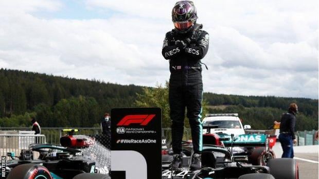 Lewis Hamilton on top of his car paying tribute to Chadwick Boseman