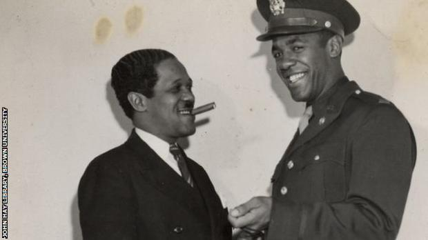 Pollard, with cigar, pictured in 1950 with his son Fritz Jr.