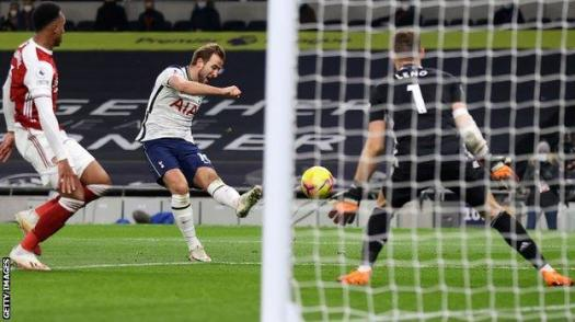 Harry Kane scores against Arsenal