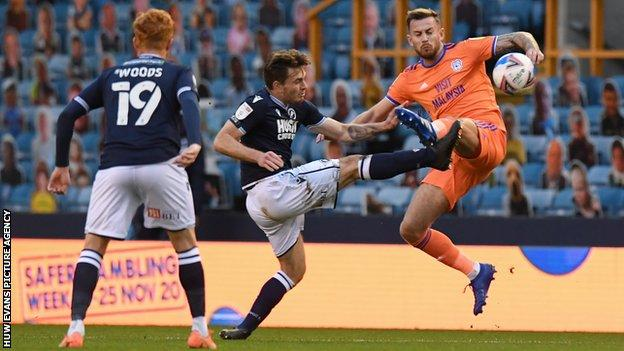 Millwall's Ben Thompson battles for possession with Cardiff City's Joe Ralls