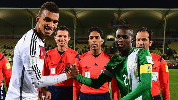 Kevin Akpoguma as captain of Germany at the 2015 Under-20 World Cup shake hands with Nigeria's captain Musa Mohamed