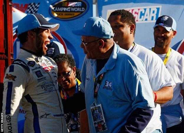 sport Wendell Scott Jr congratulates Bubba Wallace on a 2013 victory, with Warrick also present