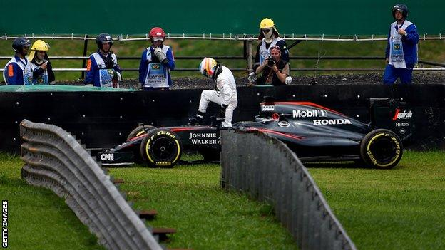 Fernando Alonso gets out of his McLaren during qualifying for the Brazilian Grand Prix in 2015