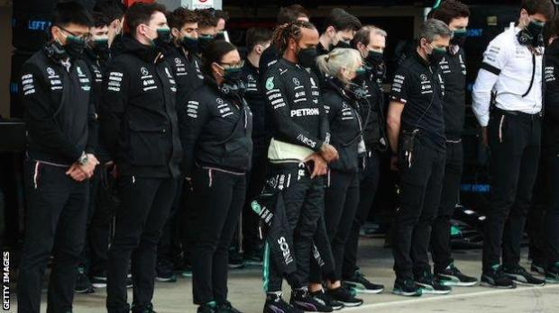 Lewis Hamilton and the Mercedes team hold a minute's silence before qualifying at Imola