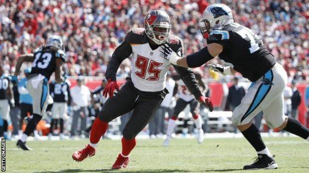 Tampa Bay Buccaneers defensive end Ryan Russell prepares to make a tackle against the Carolina Panthers in an NFL game