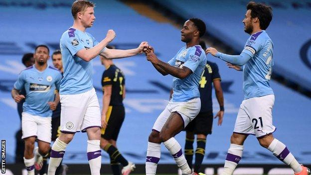 Players celebrate with Kevin de Bruyne