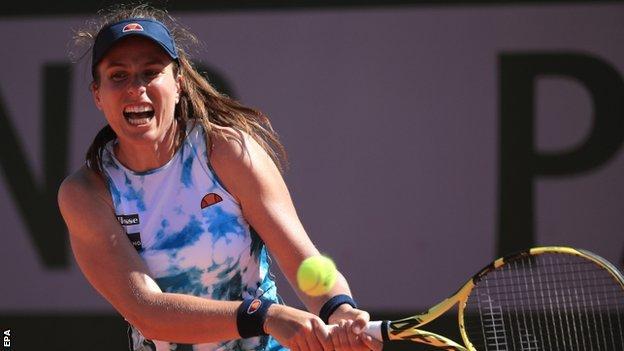 Johanna Konta returns a ball at the French Open