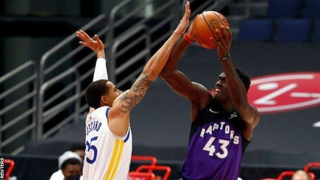 Toronto Raptors' Pascal Siakam goes up for a shot against the Golden State Warriors' Juan Toscano-Anderson