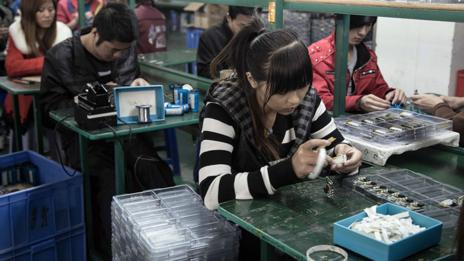 Workers in a factory in Shenzhen make MP3 players (Credit: Kate Davies/Unknown Fields)