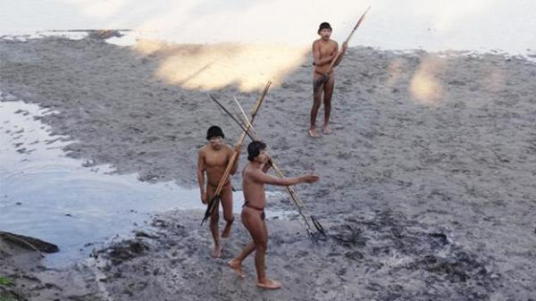 Several members of an isolated indigenous tribe from the Amazon (Funai) (Credit: Funai)