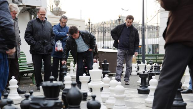 Men play chess in Geneva's Parc des Bastions (Credit: Credit: Martin Good/Thinkstock)