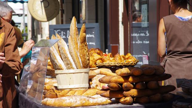 Shopping for bread is part of daily life in Dijon, France (Credit: Credit: Stephen Chapman/Alamy)