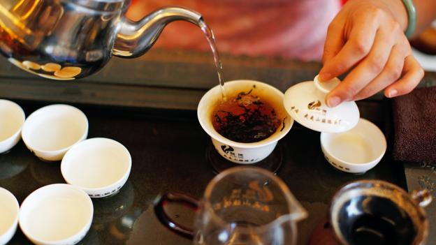 In China, drinking tea is considered an art form (Credit: Credit: Kevin Zen/Getty)