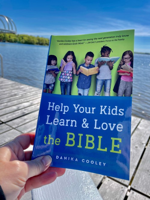 """Reading """"Help Your Kids Learn & Love the Bible"""" by the lake. Learn more about the book for moms and get a free tool kit."""