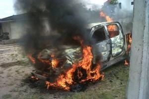 Vandalized vehicle at Kokori