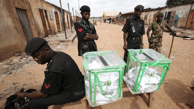 Security men at a polling unit guarding ballot boxes