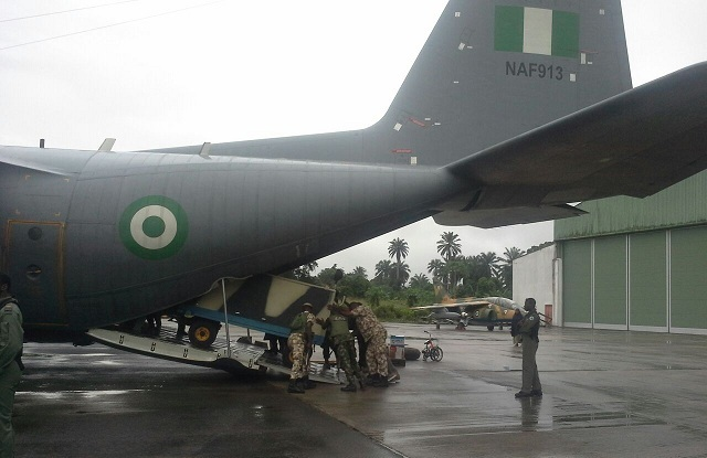 NAF technicians offloading ground  support equipment in support of the newly  deployed fleet